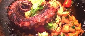 Octopus is an entree on the menu of USS Nemo Restaurant