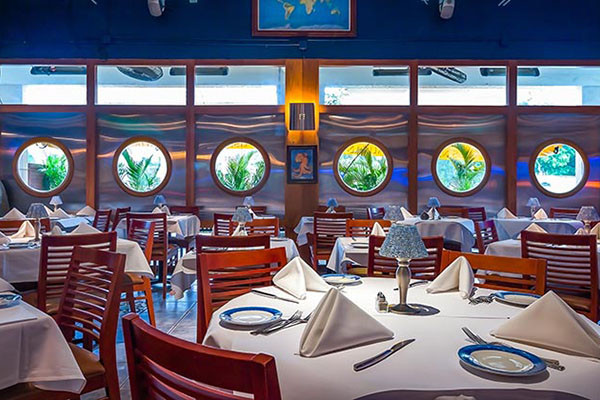 "The Naples seafood restaurant with porthole windows. U.S.S. Nemo's has a submarine, ""under the sea"" motif that is a whimsical and elegant dining atmosphere."