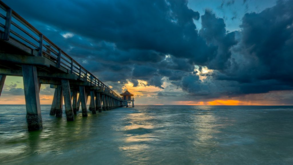 Naples Pier at sunset, an evening thunderstorm is approaching