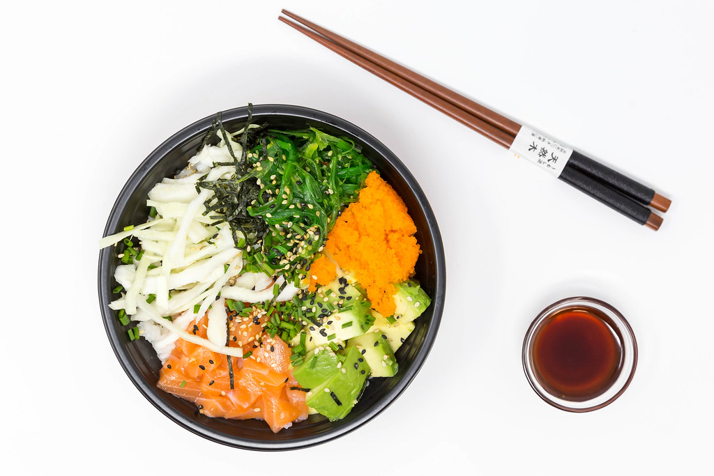poke bowl with chop sticks and sauce